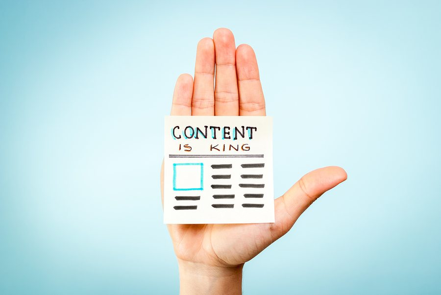 Hand making stop gesture, content marketing is king, newspaper
