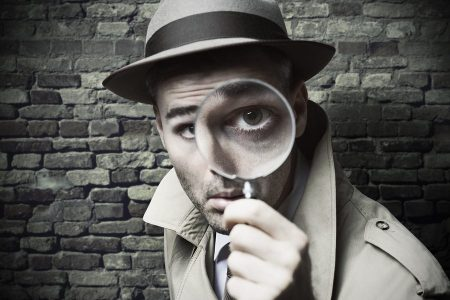 Vintage Detective Looking Through A Magnifier