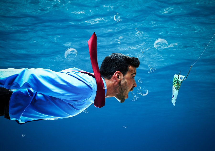 Underwater scene of a businessman taking the bait
