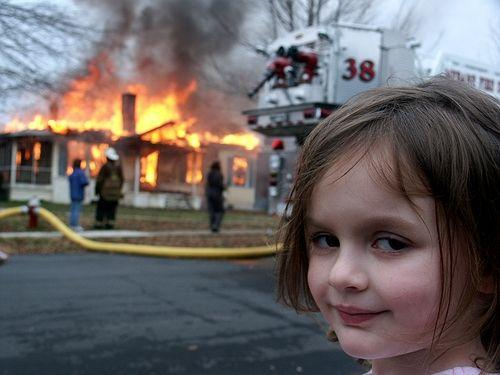 Buzzfeed Buzzfeed disaster-girl in front of a burning house